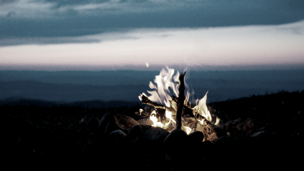teepee style campfire burning
