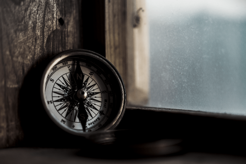 compass sitting upright against a wall