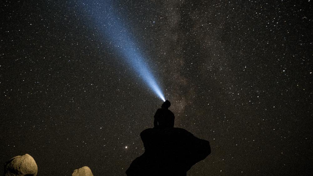 headlamp pointing toward the night sky