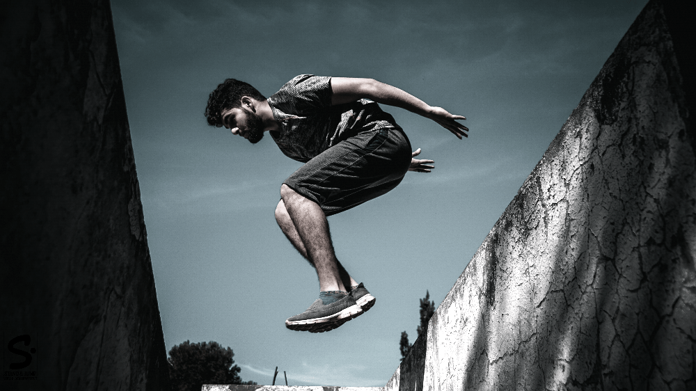 man vaulting over a ledge